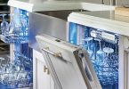 Two Thermador Star Sapphire Dishwashers open with dishes