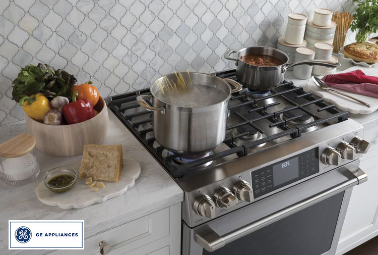 GE Cafe slide in range with pasta and sauce on gas burners
