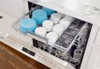 Open Bosch Benchmark dishwasher with loaded MyWay rack