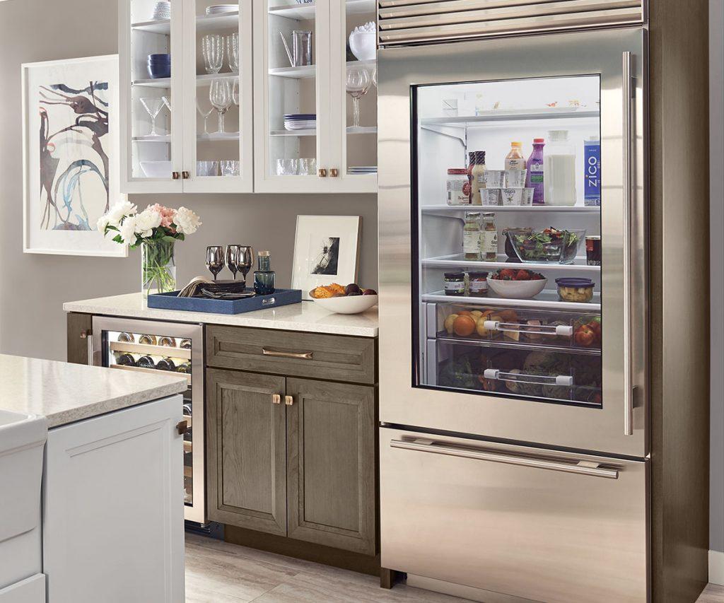 Kitchen with a Sub-Zero glass door fridge